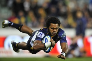 ACT Brumbies' Henry Speight scores a try during the round 17 Super Rugby match between the ACT Brumbies and the Melbourne Rebels at Canberra Stadium in Canberra, Friday, June 7, 2013. (AAP Image/Lukas Coch) NO ARCHIVING, EDITORIAL USE ONLY